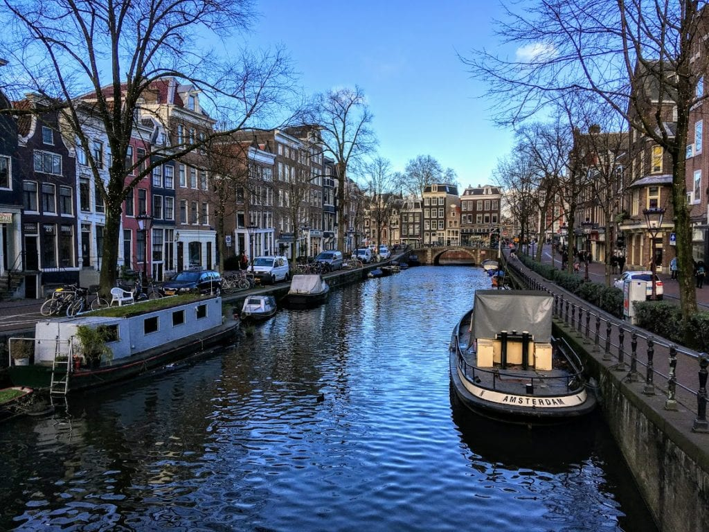 Amsterdam canal with canalboats in January 2019.