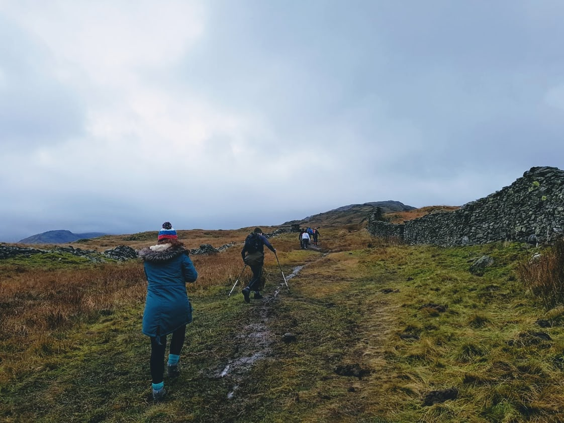 Hiking on a gloomy day in Ambleside, Lake District National Park, UK. Winter 2019