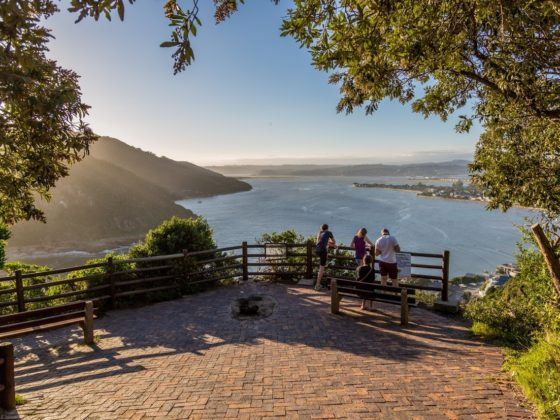 tourists admiring the view at the Knysna Heads in South Africa