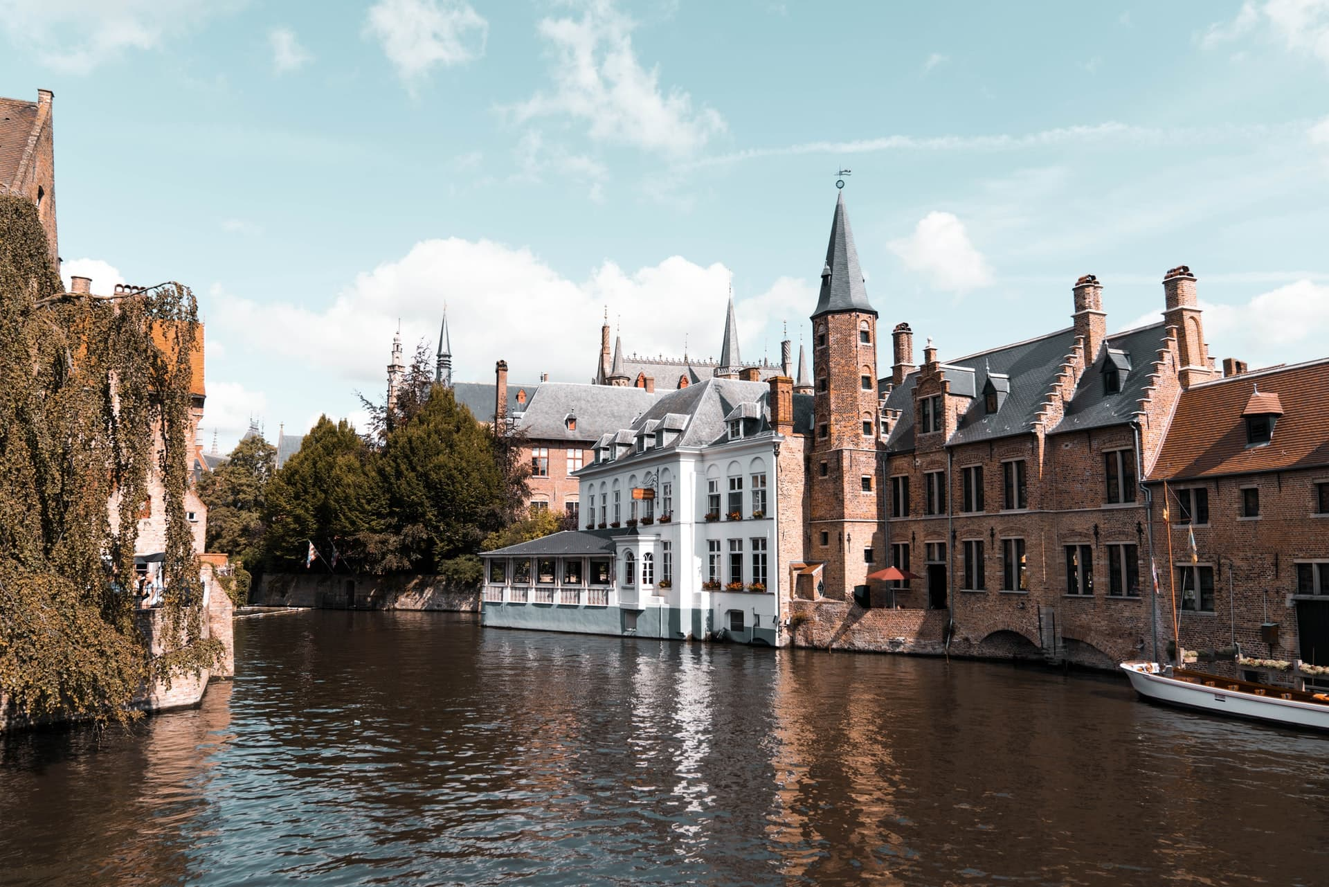 Boat tour in Bruges, Belgium - stop 1 on this one day in Bruges itinerary.