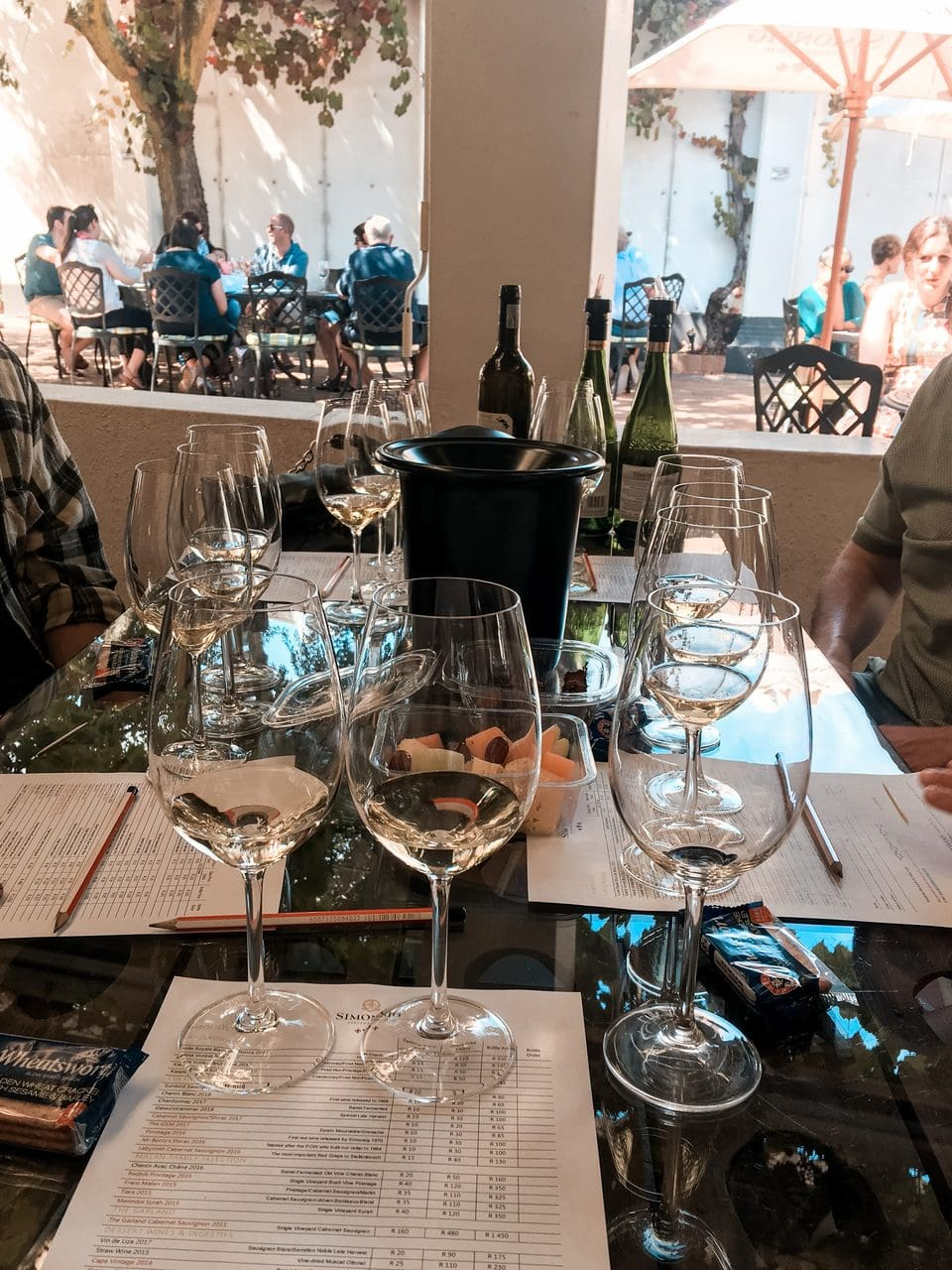 People drinking wine at a wine estate in stellenbosch south africa.