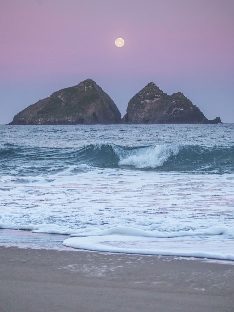 Full moon over Holywell Bay in Newquay Cornwall.