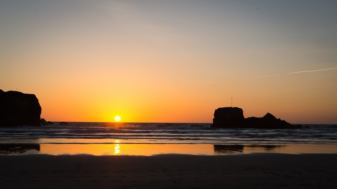 Sunset at Chapel Rock in Perranporth, England. Most romantic breaks in Cornwall