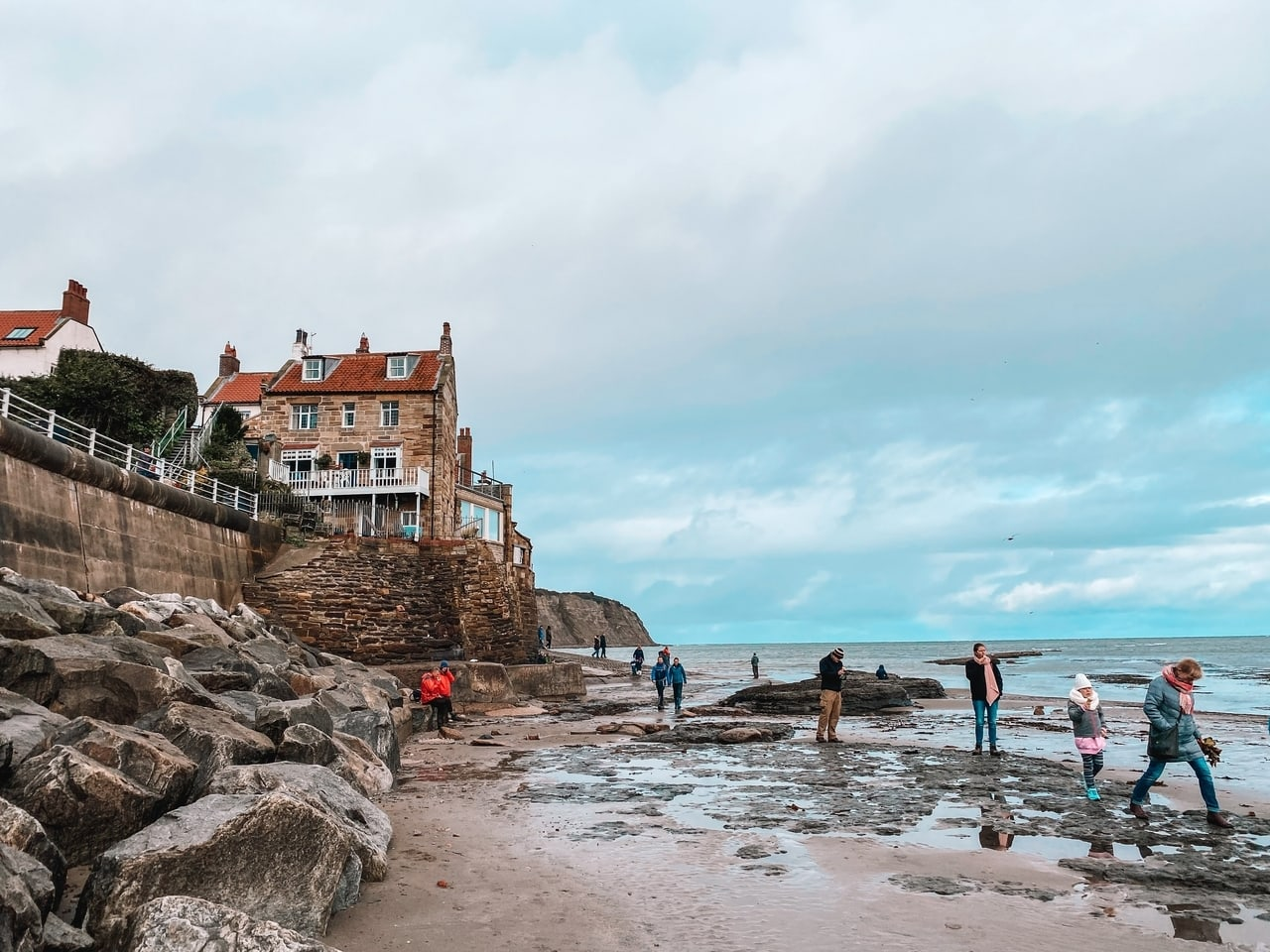 People playing on the beach at Robin Hood's Bay on the North Yorkshire Coast