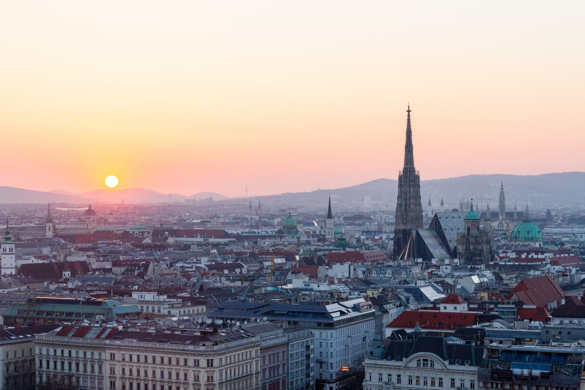 Sunset over the city of Vienna, a great place for backpackers and solo travel during 2 or 3 days in Vienna.