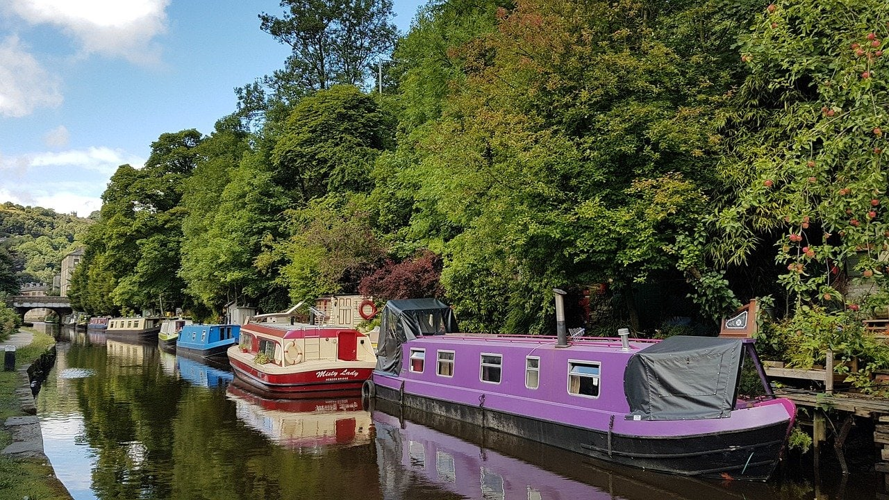 Hebden Bridge canal with colourful barges