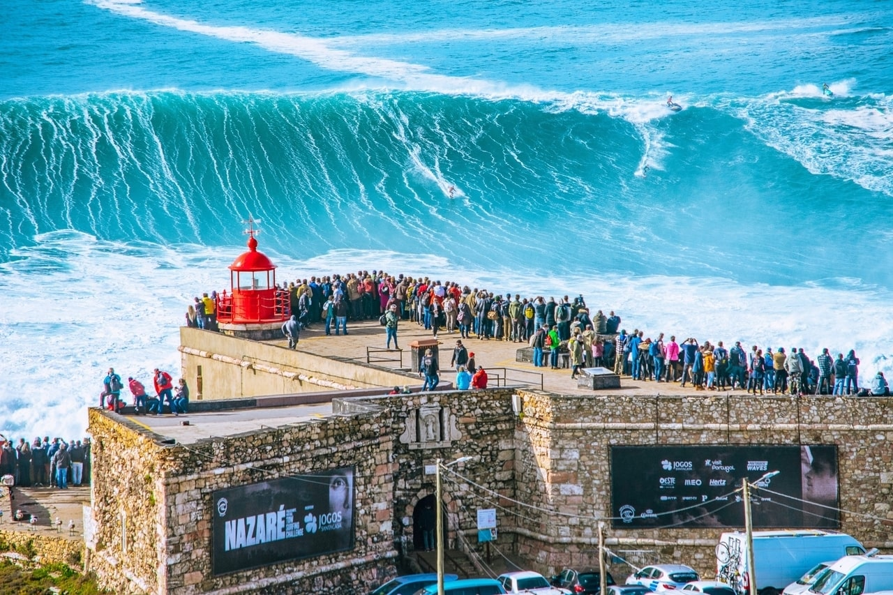 Watching the big waves surfing in Nazare Portugal