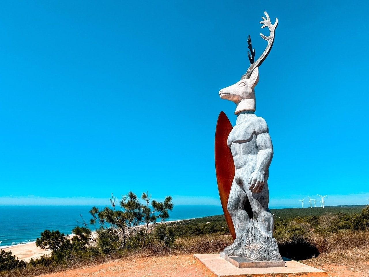 A sculpture and viewpoint overlooking the beach in Portugal.