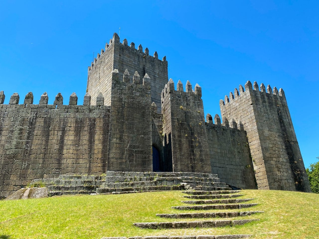 Guimaraes Castle in summer, a day trip you can do in this 2 days in Porto itinerary